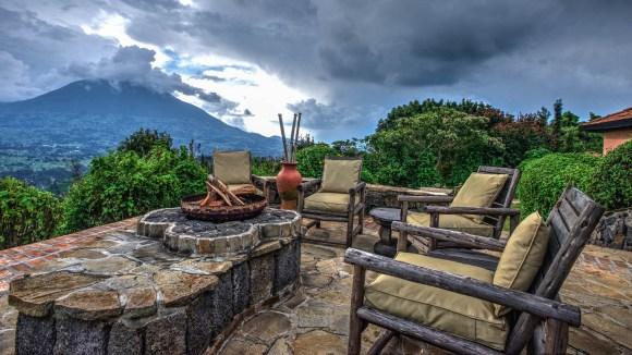 rwanda-volcanoes-virunga-lodge-randazoo-outdoor-seating-with-view-and-fire