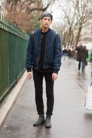 with-black-sweatshirt-cuffed-pants-boots-and-cap