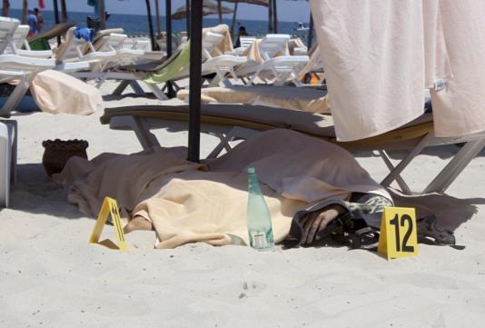 The body of a tourist shot dead by a gunman lies near a beachside hotel in Sousse, Tunisia June 26, 2015.