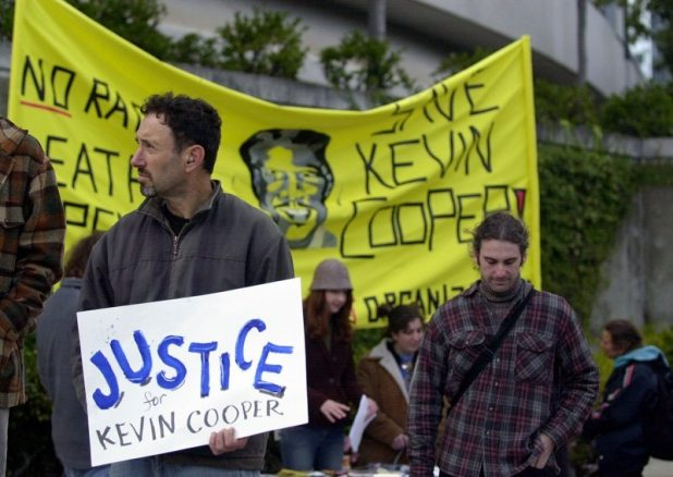 People protest the execution of Kevin Cooper as evidence suggests he may be innocent. [Photo by Marcio Jose Sanchez/AP Photo]