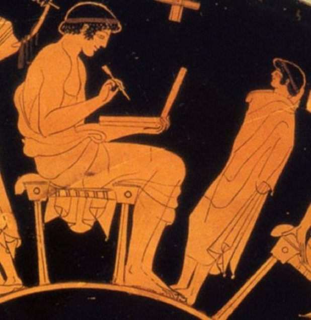 Vase painting shows ancient Greek man writing with stylus on wax tablet (c. 500 B.C.) [Image via Wikimedia Commons]
