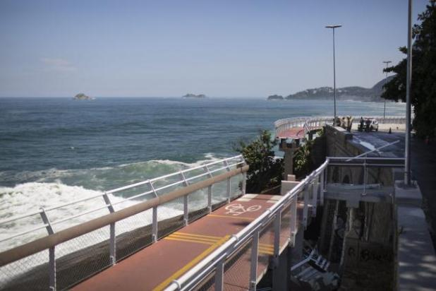 Officials believe a wave lifted a 150-foot section of a new bike path in Rio de Janeiro and sent it crashing down Thursday morning.