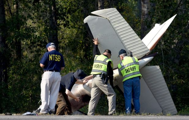 """Investigators from the National Transportation Safety Board and a Missoula County Sheriff's Reserve Deputy review the scene Monday morning of a light plane that crashed Sunday afternoon near the Rock Creek airstrip that killed Darrell Ward of """"Ice Road Truckers"""" fame and Mark Melotz of Missoula. KURT WILSON MISSOULIAN"""