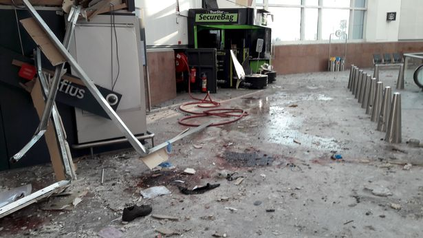 Damage is seen inside the departure terminal following the March 22 bombing at Zaventem Airport