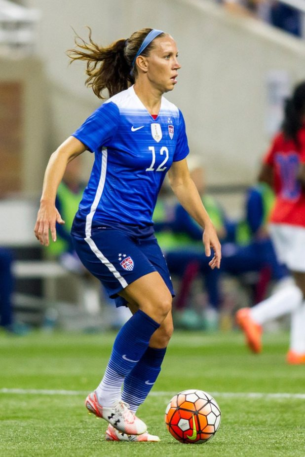 Lauren Holiday wears Under Armour sneakers during the World Cup Victory Tour match in 2015.