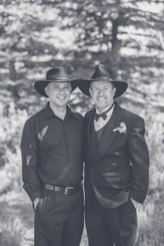 Dressed in black, cowboy hats