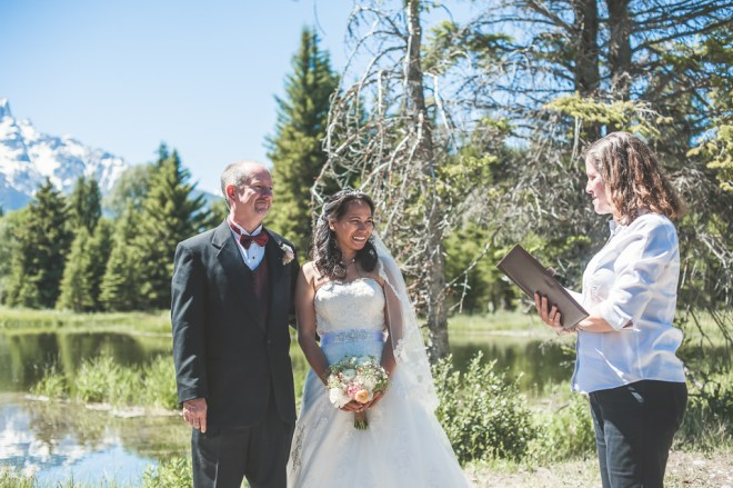 Saying wedding vows before the County Clerk and the Grant Teton Mountains