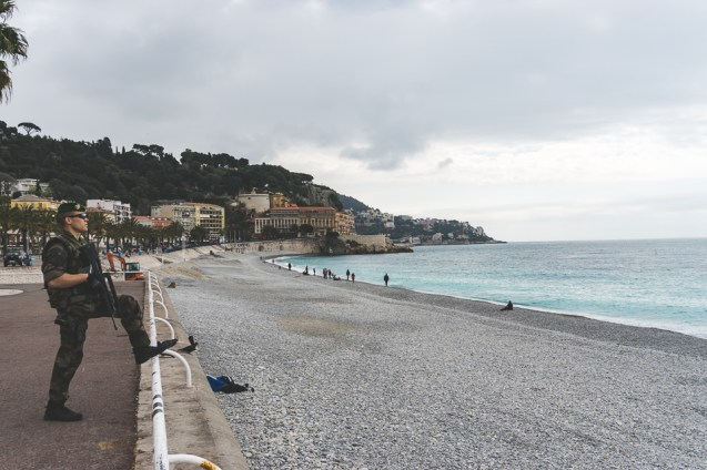 Soldier patrols the Quai des Etats-Unis along the beach in Nice, France