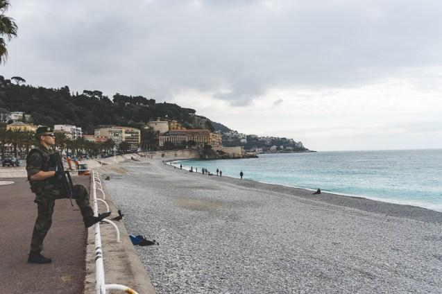 Soldier patrols the Quai des Etats-Unis along the beach in Nice, France