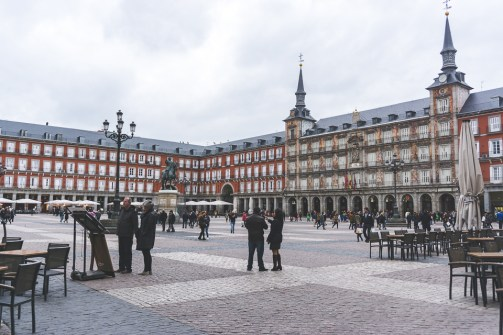 A cold, rainy morning does not stop Madrileños from enjoying the iconic Plaza Mayor