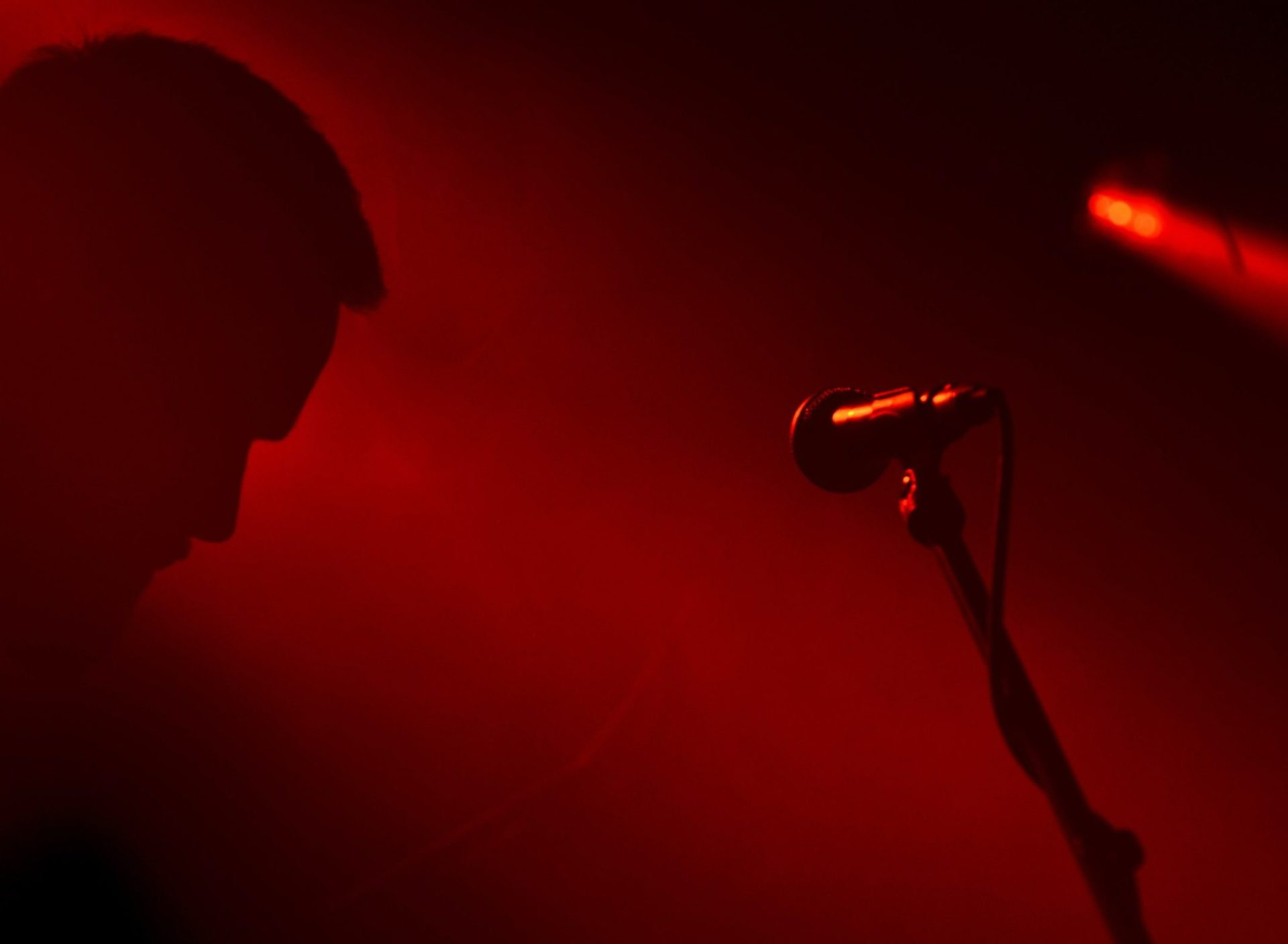 Singer or speaker on the stage in red light