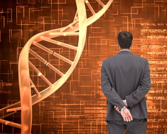 Composite image of businessman standing with hands behind back standing next to dna spiral on orange background