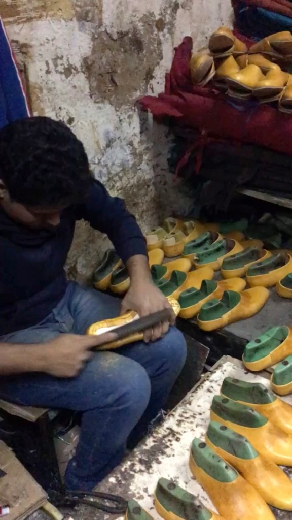 young balgha maker in the medina of Tunis