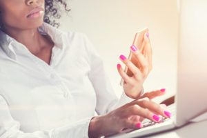 Serious African American woman with a phone