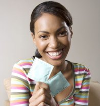 young-woman-holding-condoms