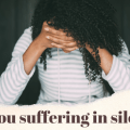 Woman holding her head with the words Are you suffering in silence