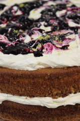 White Chocolate velvet cake layered with vanilla cloud frosting and blueberry coulis, fresh lemon zest. Photo by Robyn Joynt