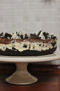 Decorate with crumbled oreos and cookie and cream Hershey's kisses.