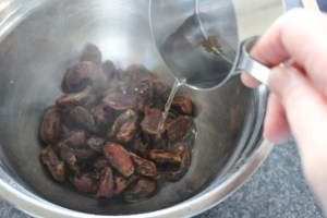 Place 2 cups dates in metal bowl, add boiling water.