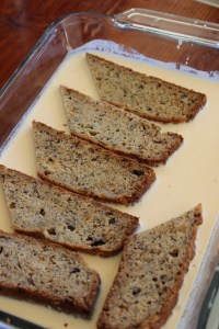 Place sliced banana bread in egg, cream and milk mixture. soak 1 minute on each side.