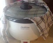 Place tea towel underneath lid. Cook on high for 2 hours.
