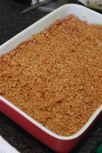 Top meat with oat topping evenly, bake for 45-50 minutes until puffed and cooked.