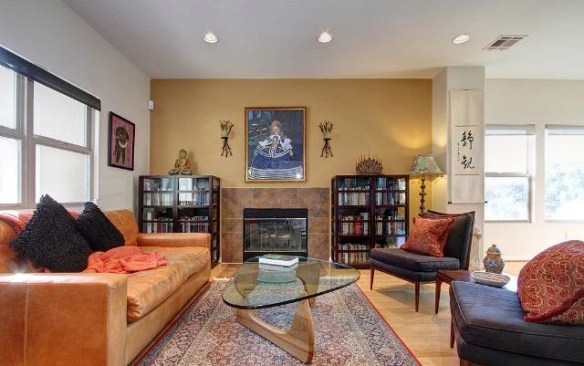 Living room with open floor plan, wood floors and fireplace