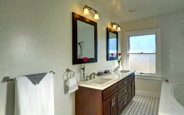 Bath with dual sinks, spa tub and hex tile flooring