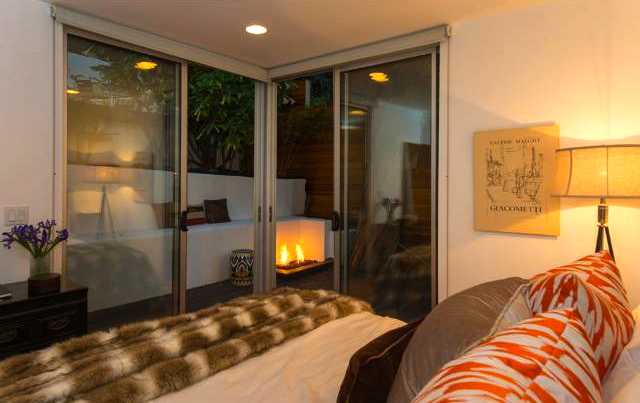 Bedroom with deck and fire pit