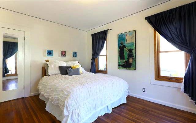 Bedroom with wood windows