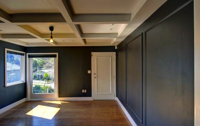 Living room with wood floors and coffered ceiling