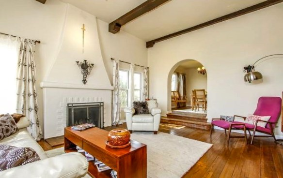 Living room with original wood floors, fireplace and beamed ceiling