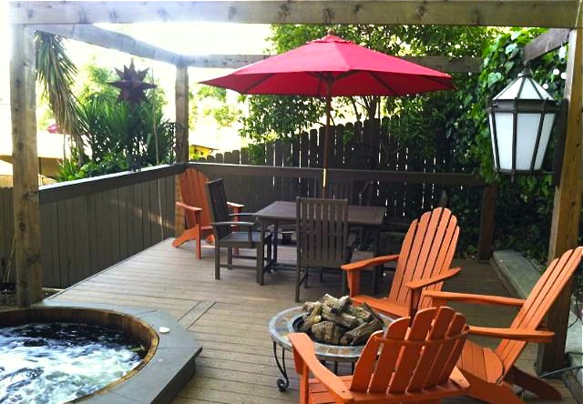 Upper deck with hot tub. Courtesy of Michael Cogley – Coldwell Banker