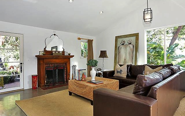 Living room with vaulted ceiling, fireplace and concrete floors