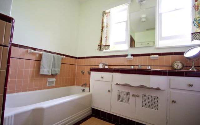 Original bath with built-in sink vanity