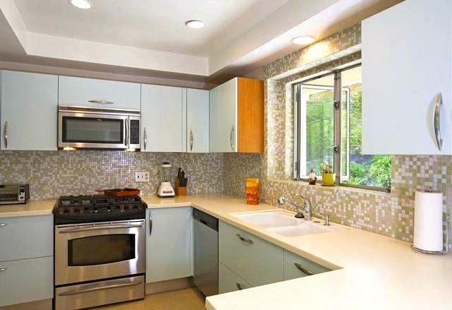 Kitchen with mosaic tile backsplash