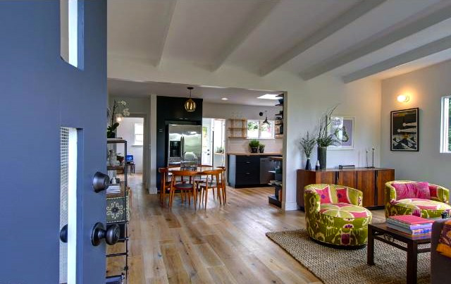 Living room with wood floors, open floor plan and vaulted ceilings