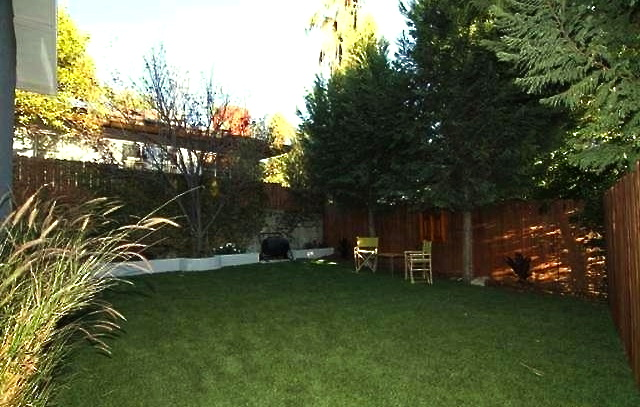 Flat back yard. Courtesy of Miguel Pedraza -- Housing America