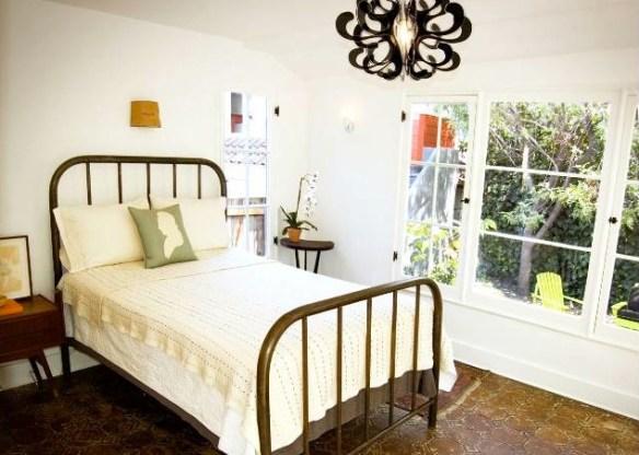 Los Feliz bedroom with a wall of original windows