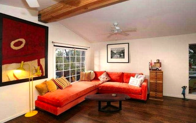 Living room with wood floors and beamed/vaulted ceiling