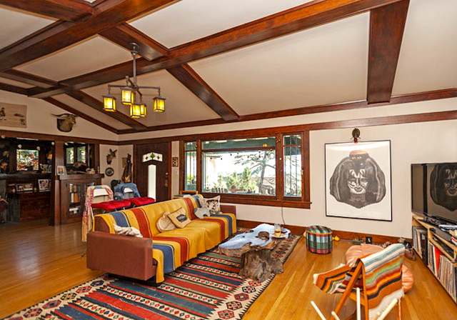 Living room with barreled coffered ceilings, wood floors and fireplace