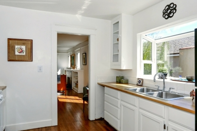 Galley kitchen with built-in breakfast nook