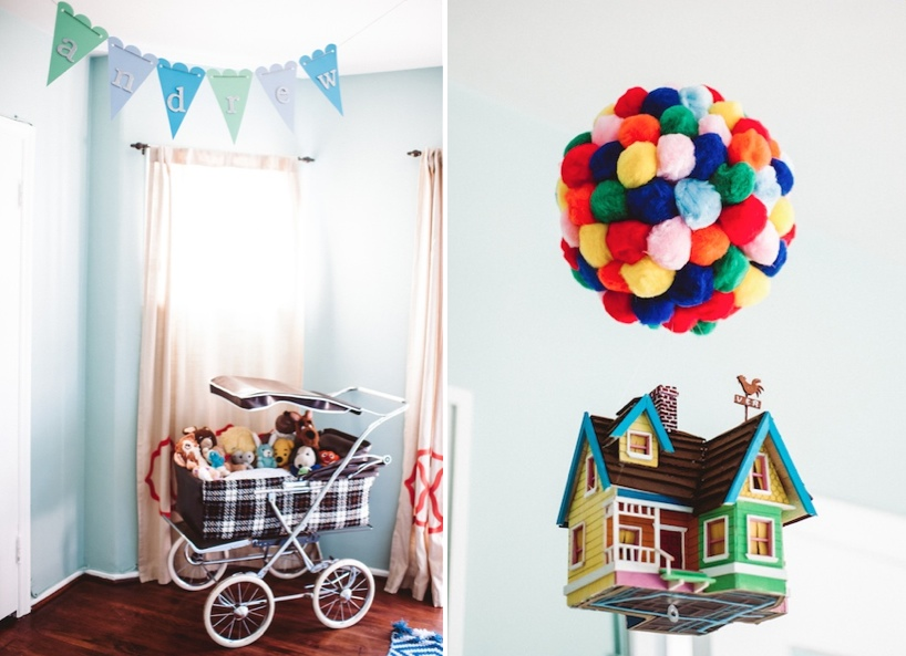 "Vintage stroller used as a toy chest and ""Up"" balloons from pom poms"