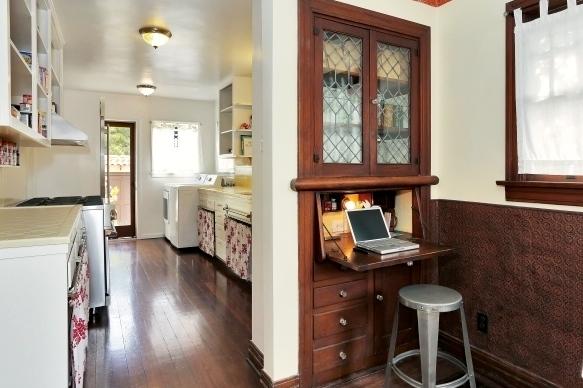 Galley kitchen and original built-in desk