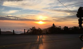 Sun setting over Bucaramanga, Colombia. Taken from a mountain road by Peter Thompson.