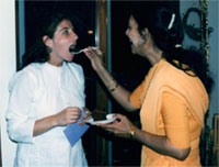 Yol Swan being fed by Sri Anandi Ma on her birthday