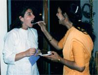 Yol Swan being fed by Sri Anandi Ma on her birthday