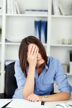 overworked entrepreneur needing a conscious business coach