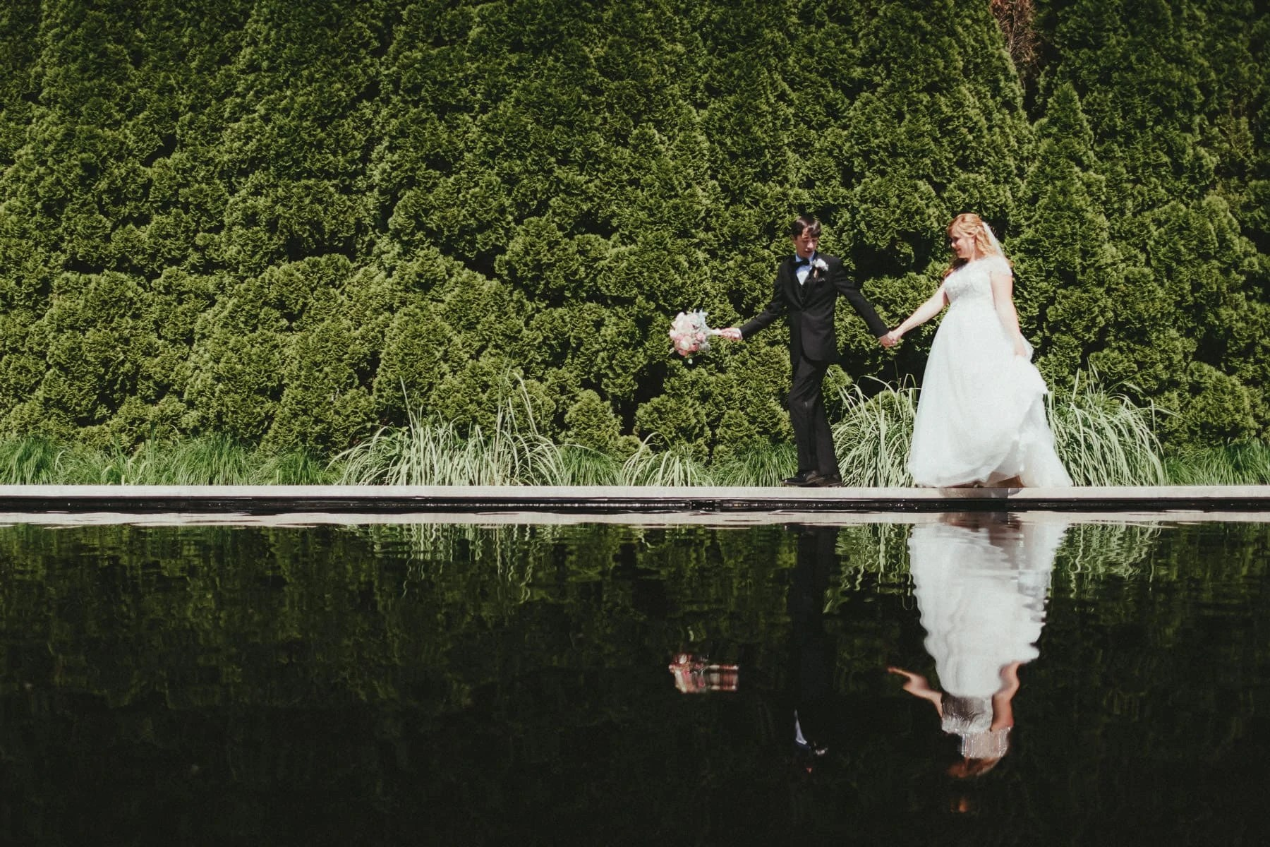 Bride and Groom reflection in the pond