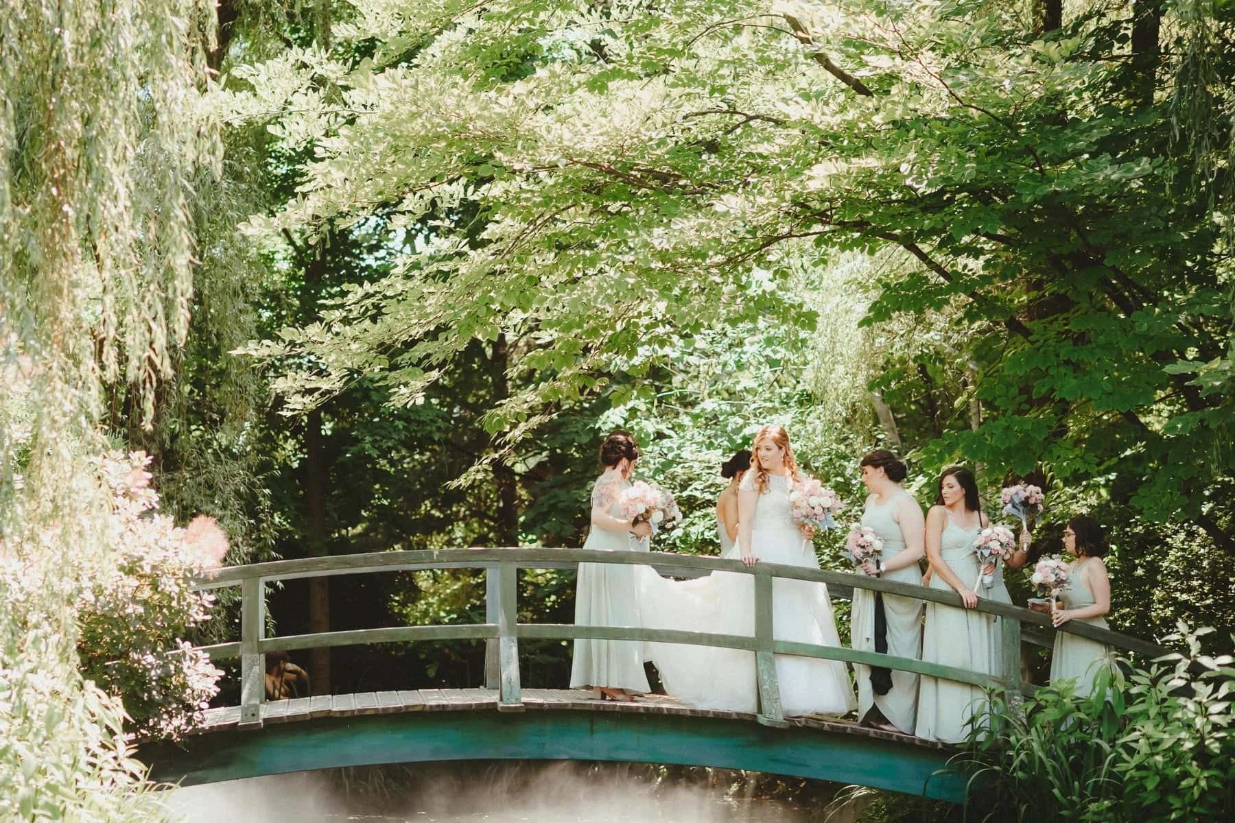 Bridesmaids on the bridge at sculpture garden